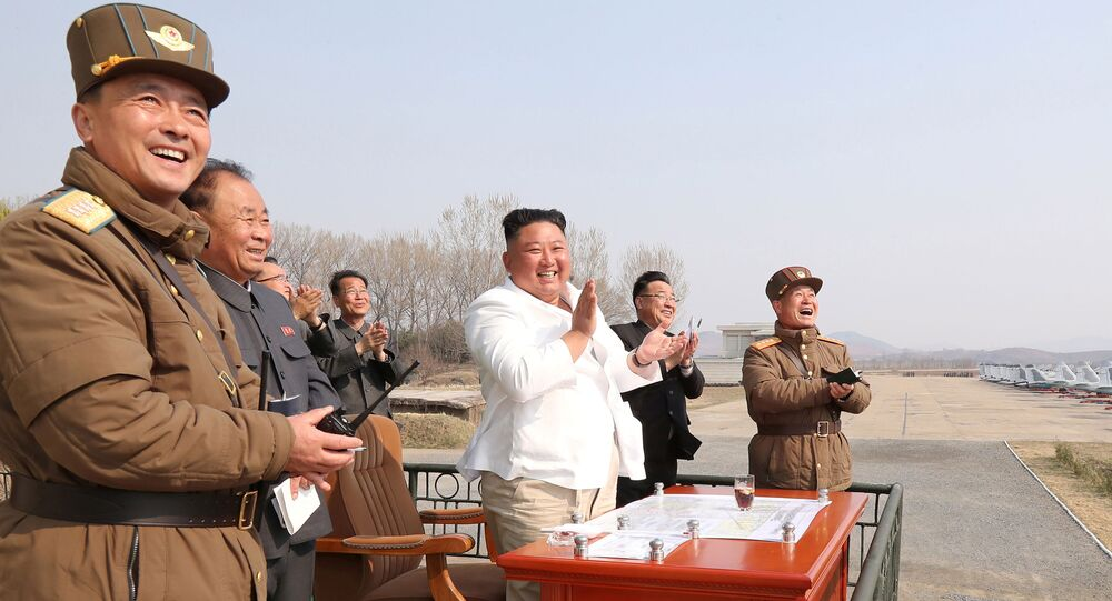 North Korean leader Kim Jong Un applauds while visiting a pursuit assault plane group under the Air and Anti-Aircraft Division in the western area in this undated image released by North Korea's Korean Central News Agency (KCNA) in Pyongyang on April 12, 2020