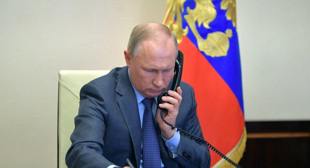 Russian President Vladimir Putin conducts a meeting with Kaliningrad Region Governor A. Alikhanov