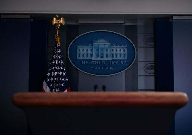 The White House briefing room podium is dark and empty after the coronavirus task force did not hold a briefing for the second day in a row in Washington, U.S., April 26, 2020
