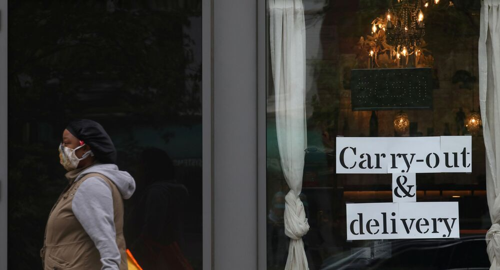 A pedestrian walks past a restaurant advertising their carry-out and delivery options during the outbreak of the coronavirus disease (COVID-19) in Washington, U.S., April 27, 2020