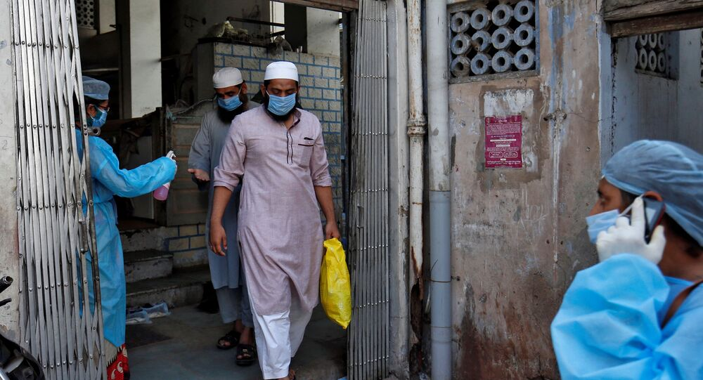 Men, who according to health and police officials had visited three Muslim missionary gatherings including in Nizamuddin area of New Delhi, wearing protective masks leave a mosque to board an ambulance that will take them to a quarantine facility amid concerns about the spread of coronavirus disease (COVID-19), in Ahmedabad, India, April 3, 2020.