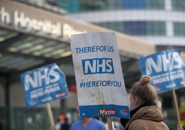 NHS signs are seen outside Queen Elizabeth Hospital during the Clap for our Carers campaign in support of the NHS, as the spread of the coronavirus disease (COVID-19) continues, in Birmingham, Britain, April 23, 2020.