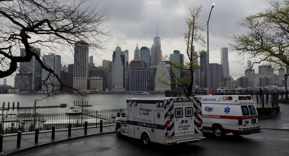 Ambulances park toward the Manhattan skyline