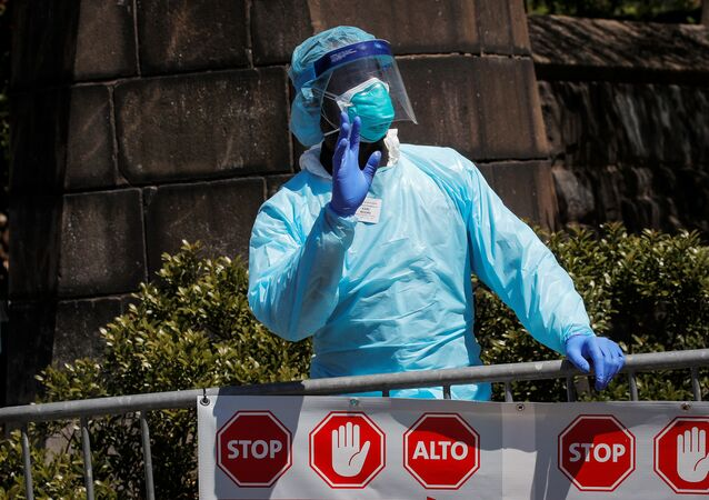 A healthcare worker greats people outside the Brooklyn Hospital Center, during the outbreak of coronavirus disease (COVID-19) in the Brooklyn borough of New York City, New York, U.S., April 28, 2020