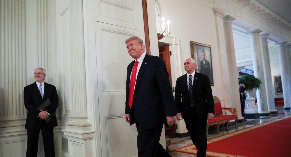 U.S. President Donald Trump is accompanied by Vice President Mike Pence at the White House in Washington, U.S., April 29, 2020