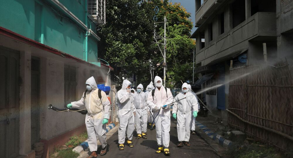 The spread of the coronavirus disease (COVID-19) in Kolkata Municipal workers wearing protective gear spray disinfectant in a residential area during a nationwide lockdown to slow the spreading of the coronavirus disease (COVID-19), in Kolkata, India, April 29, 2020.