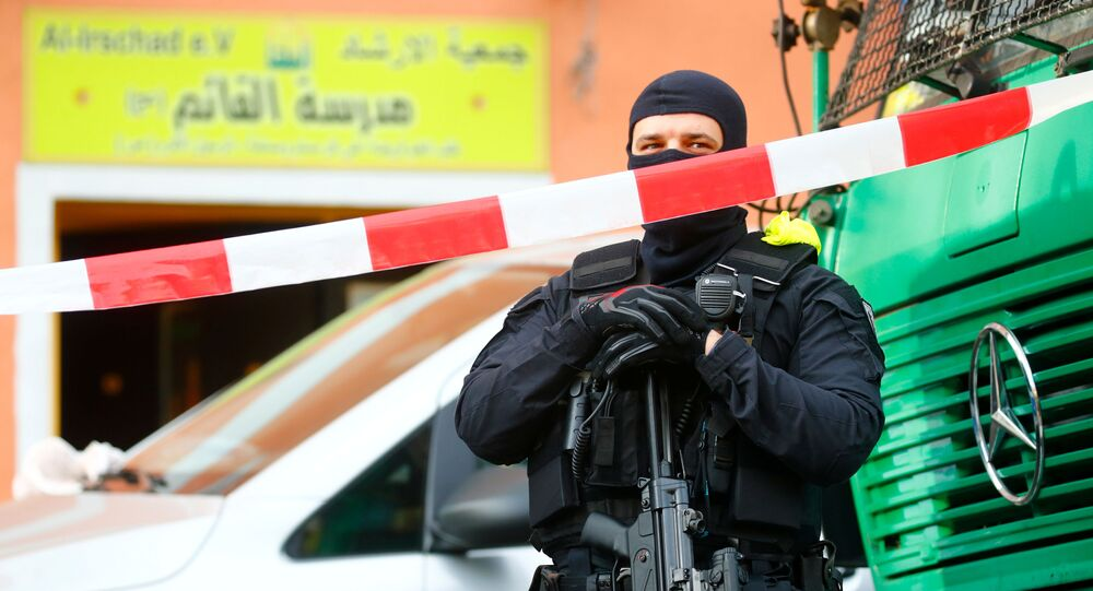 German special police guards the entrance of the El-Irschad (Al-Iraschad e.V.) centre in Berlin, Germany, April 30, 2020, after Germany has banned Iran-backed Hezbollah on its soil and designated it a terrorist organisation