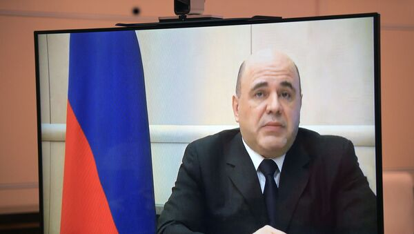 Russian Prime Minister Mikhail Mishustin (on monitor) during a video conference with Russian President Vladimir Putin. - Sputnik International