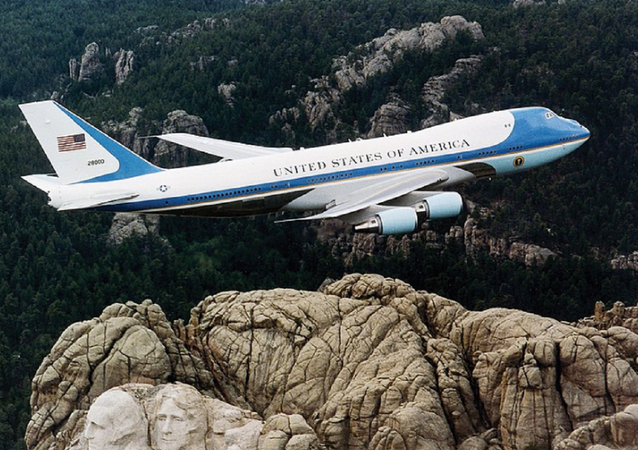 Air Force One, the typical air transport of the President of the United States of America, flying over Mount Rushmore.