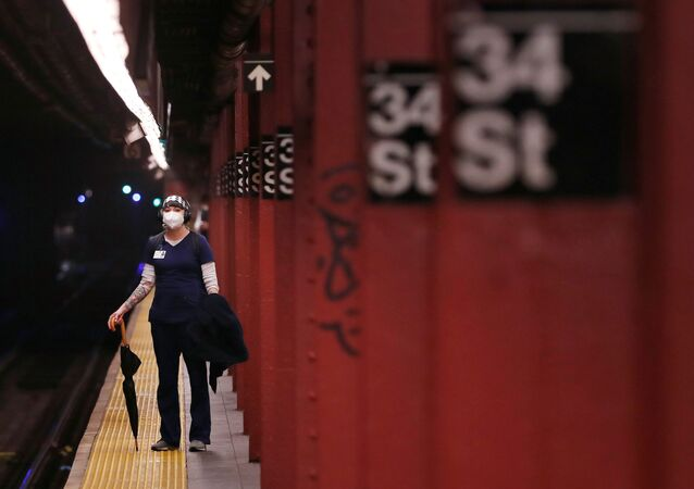 A woman wears a mask while waiting to ride the New York City Subway as the outbreak of the coronavirus disease (COVID-19) continues in the Manhattan borough of New York, U.S., April 30, 2020