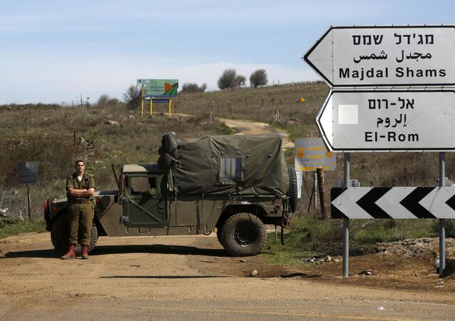 Israeli soldiers block a road leading to the Syrian border in the Israeli-annexed Golan Heights on March 5, 2020. - Syrian air defence responded to Israeli missiles targeting the south and centre of the country, state media said early today. Our air defence confronted an Israeli missile attack in the southwest of Quneitra province in the south and also in a central region, SANA news agency said. The short statement released after midnight did not provide details on the targets. Quneitra province is near the Israeli-annexed Golan Heights.