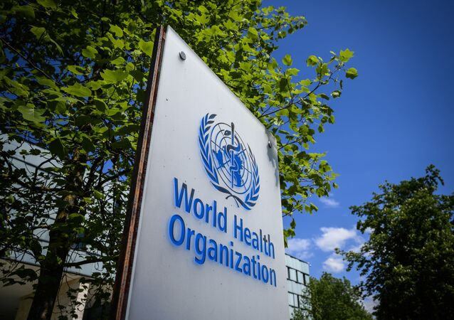This picture taken on April 24, 2020 shows a sign of the World Health Organization (WHO) in Geneva next to their headquarters, amid the COVID-19 outbreak, caused by the novel coronavirus