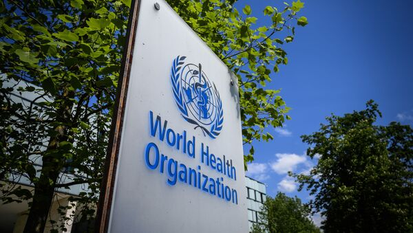 This picture taken on April 24, 2020 shows a sign of the World Health Organization (WHO) in Geneva next to their headquarters, amid the COVID-19 outbreak, caused by the novel coronavirus - Sputnik International