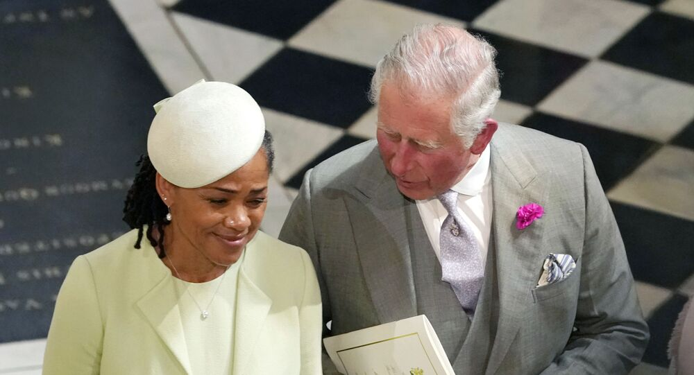 Britain's Prince Charles and Doria Ragland, mother of the bride, depart after the wedding ceremony of Prince Harry and Meghan Markle