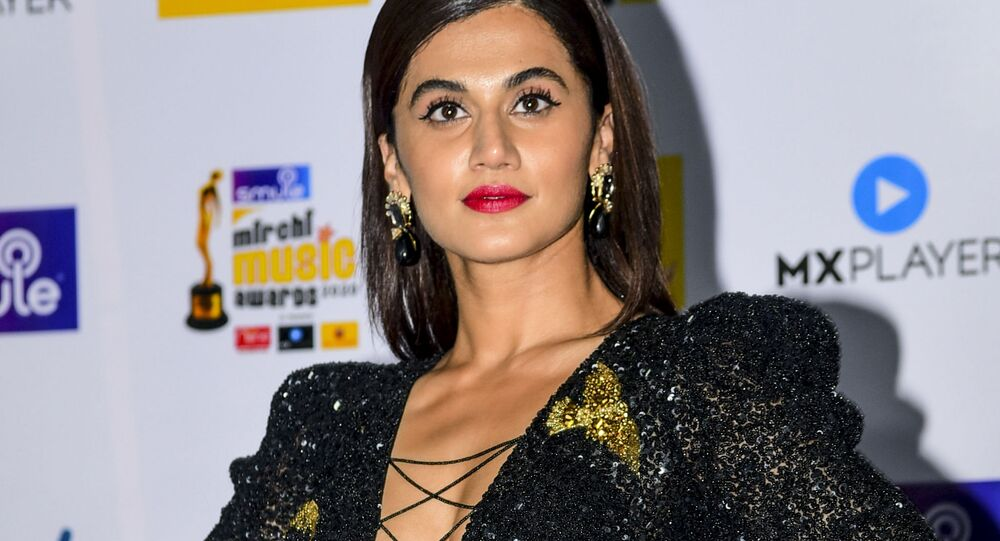 In this picture taken on February 19, 2020, Bollywood actress Taapsee Pannu poses for photographs as she arrives at the '12th Radio Mirchi Music Awards 2020' in Mumbai