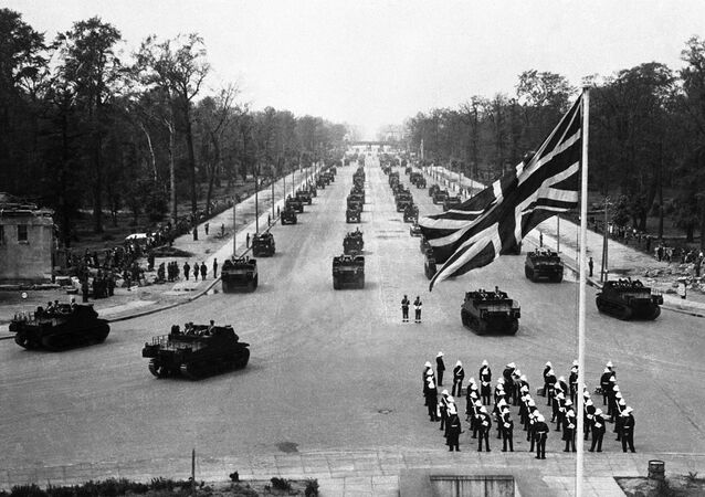 British troops and tanks parading towards the Charlottenburg Gate in the heart of Berlin in July 1945