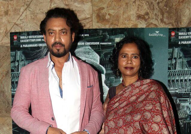 Indian Bollywood actor Irrfan Khan with his wife Sutapa Sikdar attend a screening of Hindi film 'Madaari' in Mumbai on July 20, 2016