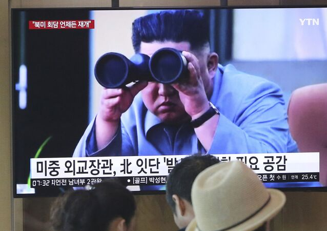 People watch a TV showing a file footage of North Korean leader Kim Jong Un during a news program at the Seoul Railway Station in Seoul, South Korea, Friday, Aug. 2, 2019