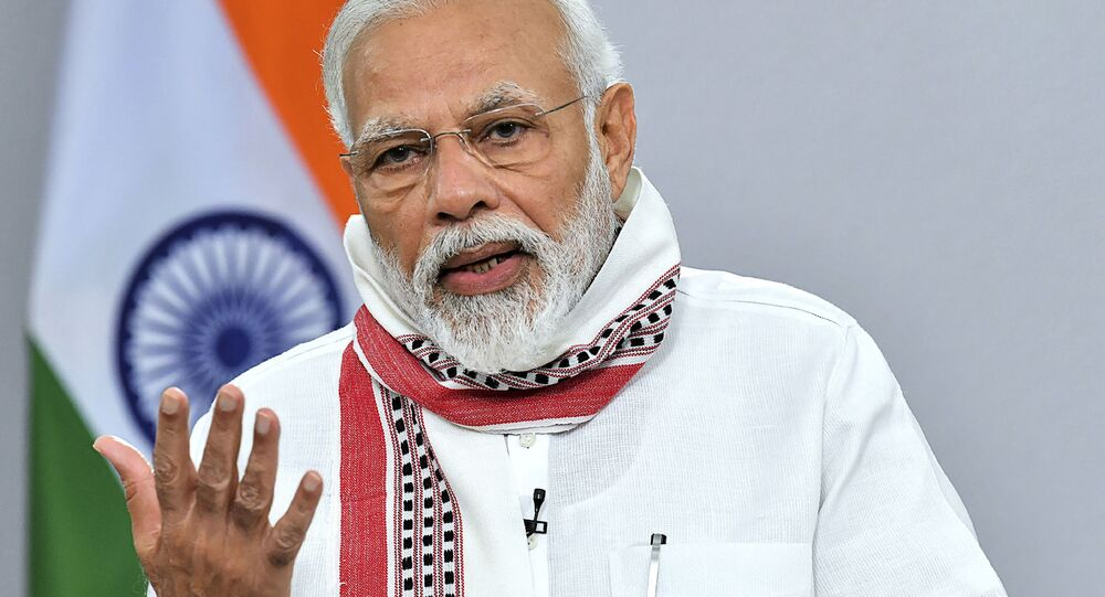 In this handout photo taken and released by Indian Press Information Bureau (PIB) on April 14, 2020, India's Prime Minister Narendra Modi addresses to the nation during a government-imposed nationwide lockdown as a preventive measure against the COVID-19 coronavirus, in New Delhi