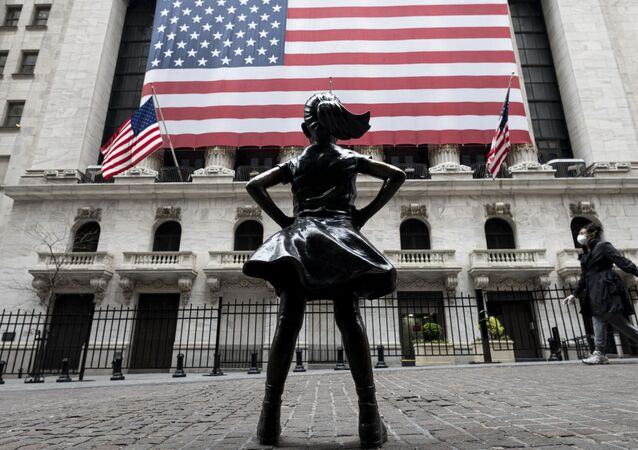 In this file photo The Fearless Girl statue and the New York Stock Exchange (NYSE) are pictured on April 20, 2020 at Wall Street in New York City. - Wall Street stocks jumped early April 28, 2020, extending April's upward trend after mixed earnings from a wide range of large companies. About five minutes into trading, the Dow Jones Industrial Average stood at 24,452.99, up 1.3 percent.The broad-based S&P 500 gained 1.2 percent to 2,913.24, while the tech-rich Nasdaq Composite Index advanced 0.9 percent to 8,807.81.