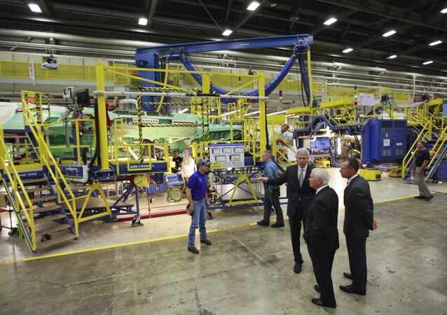 In this Aug. 31, 2009 file photo, Lockheed Martin Executive Vice President of the F-35 program Dan Crowley, left, and Lockheed Martin CEO Bob Stevens, right, guide then-Defense Secretary Robert Gates, center, through the F-35 Lightning II assembly line at Lockheed Martin Aeronautics Company in Fort Worth, Texas