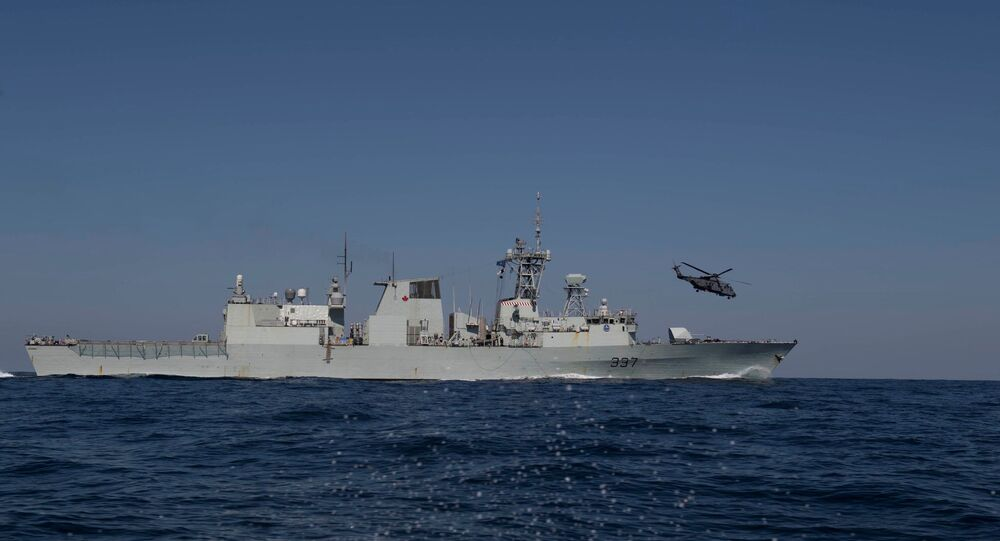 HMCS Fredericton and a helicopter