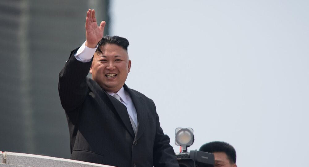 This file photo taken on April 15, 2017 shows North Korean leader Kim Jong Un waving from a balcony of the Grand People's Study House following a military parade marking the 105th anniversary of the birth of late North Korean leader Kim Il-Sung in Pyongyang.