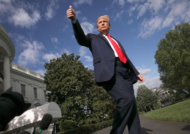 US President Donald Trump give a thumbs up to reporters and cameras as he heads to the Marine One helicopter to depart for a weekend at Camp David from the South Lawn of the White House in Washington, US, 1 May 2020.