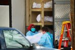 Healthcare workers transfer the body of a deceased person onto a stretcher at Kingsbrook Jewish Medical Center during the outbreak of the coronavirus disease (COVID19) in the Brooklyn borough of New York, U.S., April 8, 2020