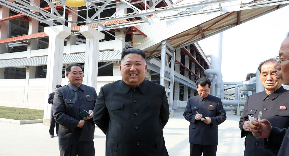 This picture taken on May 1, 2020 and released from North Korea's official Korean Central News Agency (KCNA) on May 2, 2020 shows North Korean leader Kim Jong Un (2nd L) visiting the completed Suchon phosphate fertilizer factory in South Pyongan Province, North Korea.