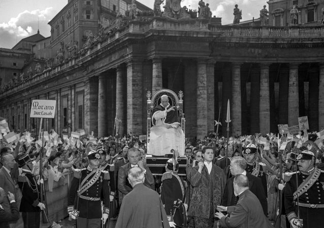 This undated photo provided by Italian news agency Ansa shows Pope Pius XII blessing young people belonging to the Gioventu Catholic Action at St. Peter's Square in the Vatican.