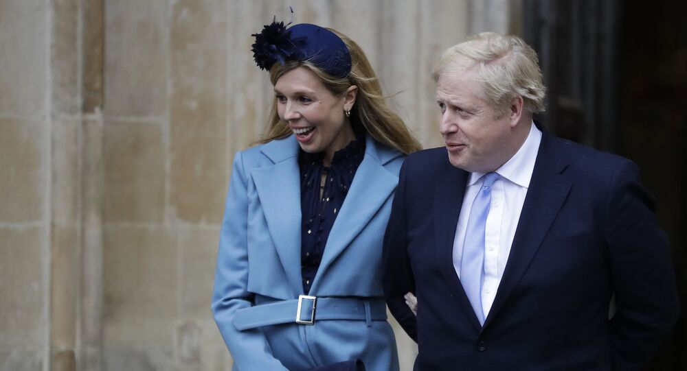 In this 9 March 2020 file photo, Britain's Prime Minister Boris Johnson and his partner Carrie Symonds arrive to attend the annual Commonwealth Day service at Westminster Abbey in London.