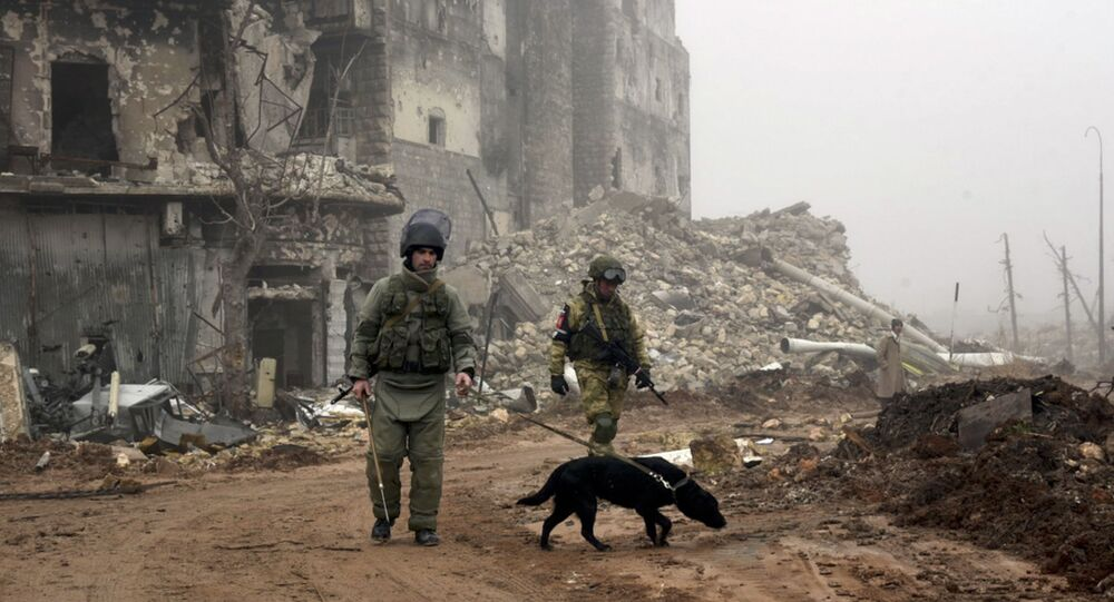 Russian sappers looking for mines in a street in Aleppo
