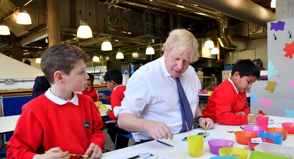 Britain's Prime Minister Boris Johnson (C) participates in a workshop with children from the Richard Avenue Primary School prior to chairing a cabinet meeting at the National Glass Centre at the University of Sunderland, in Sunderland, northeast England on January 31, 2020, the day that the UK formally leaves the European Union