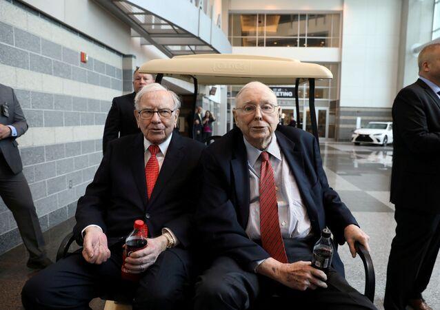 Berkshire Hathaway Chairman Warren Buffett (left) and Vice Chairman Charlie Munger are seen at the annual Berkshire shareholder shopping day in Omaha, Nebraska, U.S., May 3, 2019
