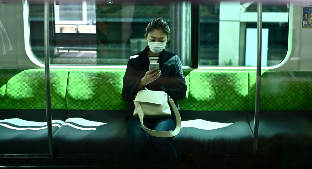 A woman with a phone in Tokyo