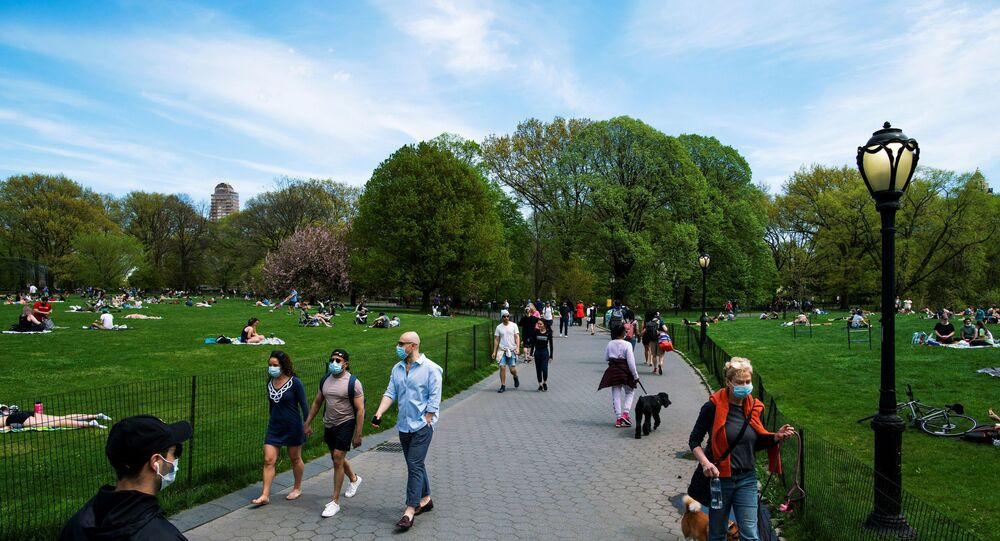 People walk around Central Park maintaining social distancing norms, during the outbreak of the coronavirus disease (COVID-19) in the Manhattan borough of New York City, U.S., May 2, 2020