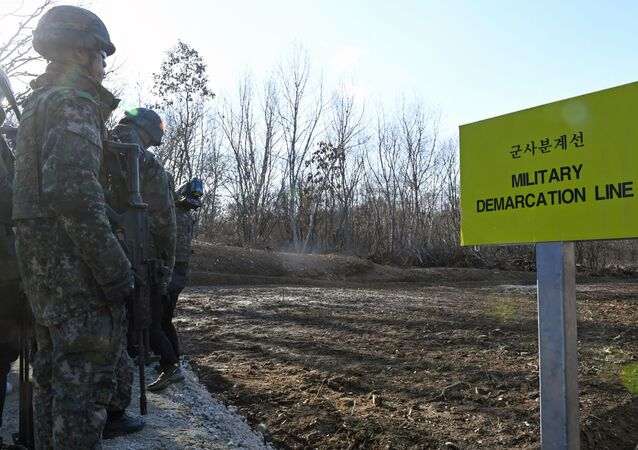 South Korean soldiers stand at Arrowhead Ridge, a site of battles in the 1950-53 Korean War, as a tactical road is built across the military demarcation line inside the Demilitarized Zone (DMZ) in the central section of the inter-Korean border in Cheorwon, Gangwon Province, in South Korea on November 22, 2018