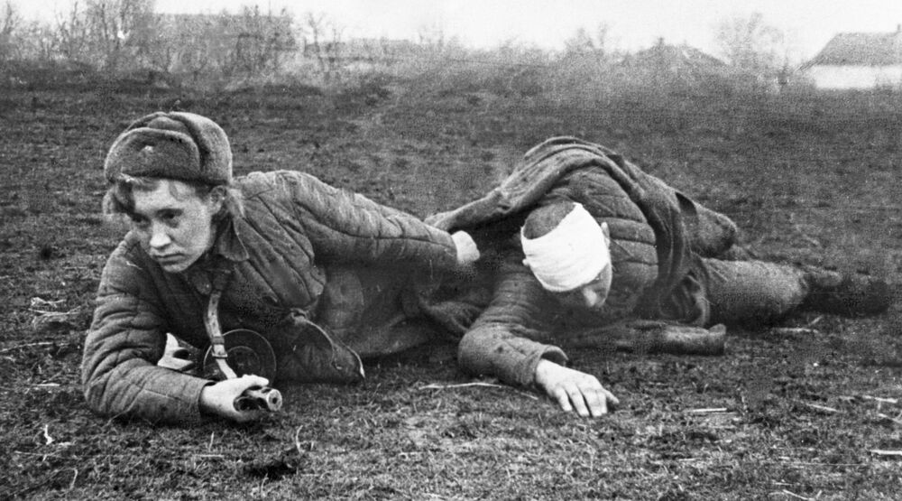 Nurse Valya Gribkova evacuates a wounded soldier from the battlefield on 31 October 1944