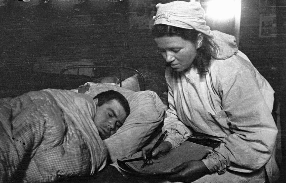 A nurse writes a letter to a wounded soldier's relatives. First Baltic Front 31 January 1944