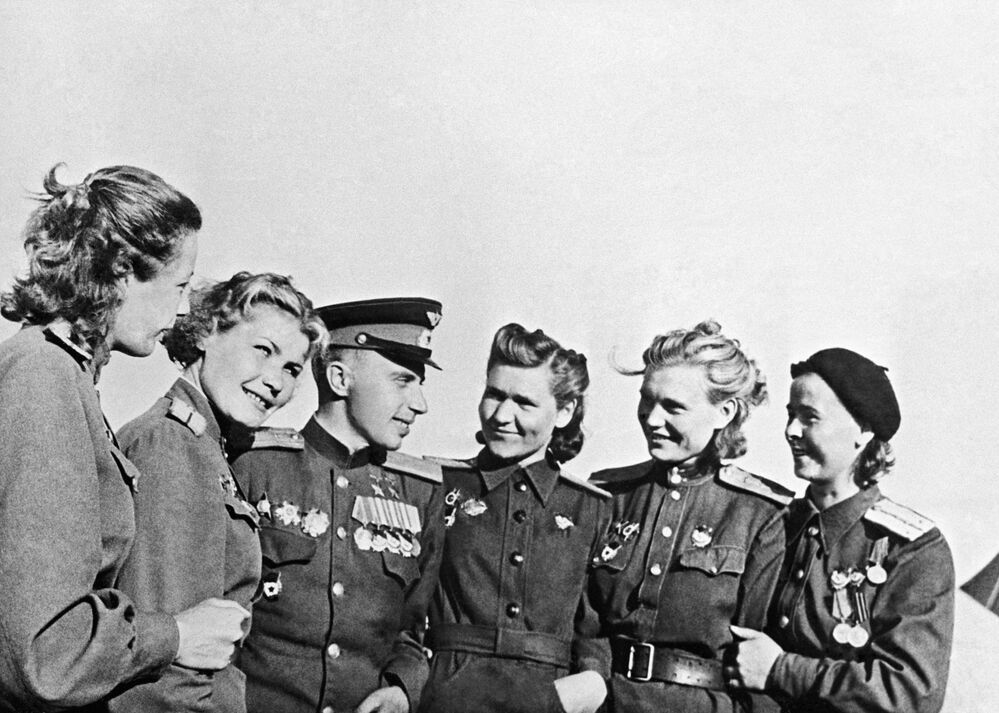 Leonid Beda, a ground-attack squadron commander, who was awarded the Hero of the Soviet Union title twice, is pictured together with female pilots on 22 May 1945