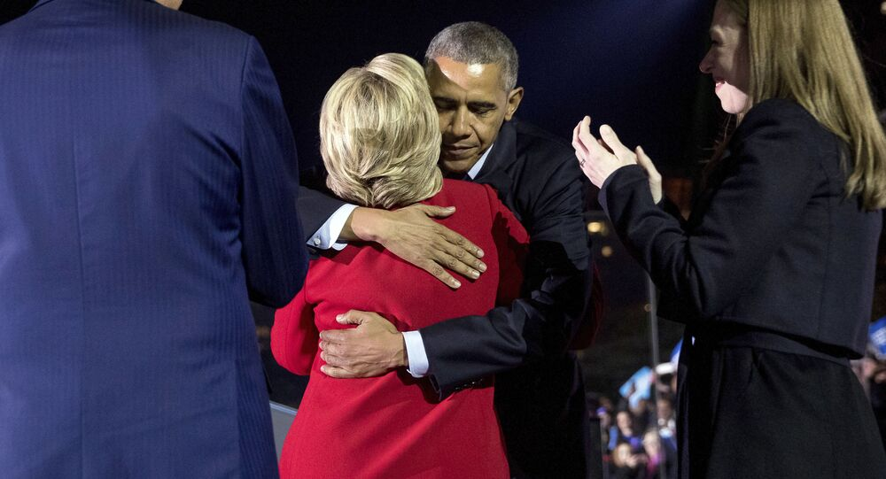 Democratic presidential candidate Hillary Clinton, accompanied by her daughter Chelsea Clinton, right, and former President Bill Clinton, left, hugs President Barack Obama after speaking at a rally at Independence Mall in Philadelphia, Monday, Nov. 7, 2016