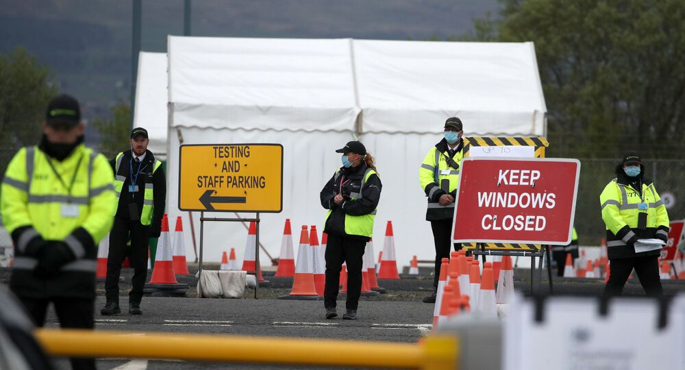 Staff direct traffic as key workers arrive for a test for the novel coronavirus Covid-19 at a drive-in testing centre at Glasgow Airport on April 29, 2020, as the UK continues in lockdown to help curb the spread of the coronavirus.