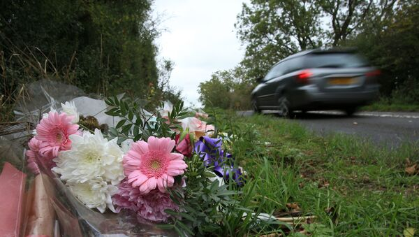 Floral tributes lay on the roadside near RAF Croughton in Northamptonshire, central England on October 10, 2019, at the spot where British motorcyclist Harry Dunn was killed as he travelled along the B4031 on August 27. - Dunn was killed on August 27 when his motorbike collided with a car near a Royal Air Force base in Northamptonshire in central England, which is used by the US military as a communications hub. - Sputnik International