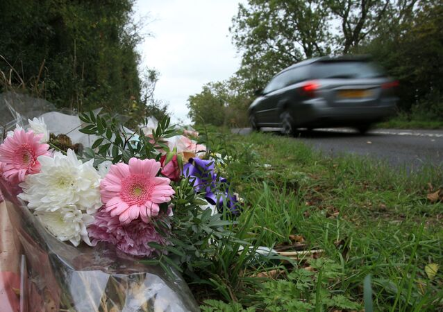 Floral tributes lay on the roadside near RAF Croughton in Northamptonshire, central England on October 10, 2019, at the spot where British motorcyclist Harry Dunn was killed as he travelled along the B4031 on August 27. - Dunn was killed on August 27 when his motorbike collided with a car near a Royal Air Force base in Northamptonshire in central England, which is used by the US military as a communications hub.