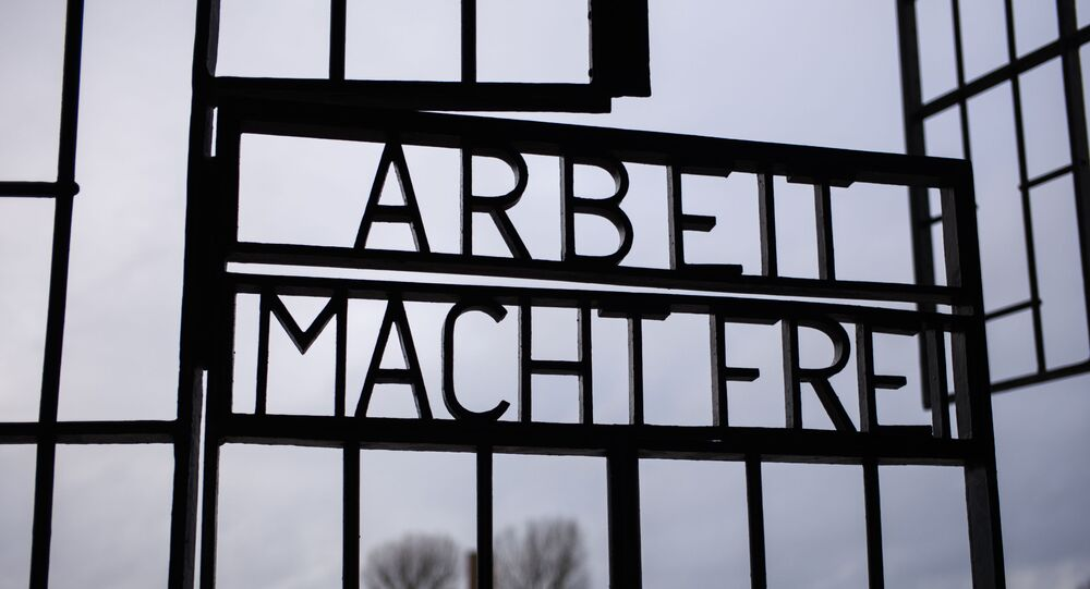 The gate of the Sachsenhausen Nazi death camp with the phrase 'Arbeit macht frei' (work sets you free) stands open at the International Holocaust Remembrance Day, in Oranienburg, about 30 kilometers, (18 miles) north of Berlin, Germany, Sunday, Jan. 27, 2019. The International Holocaust Remembrance Day marks the liberation of the Auschwitz Nazi death camp on Jan. 27, 1945.