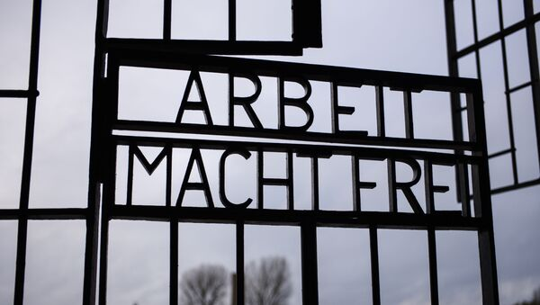 The gate of the Sachsenhausen Nazi death camp with the phrase 'Arbeit macht frei' (work sets you free) stands open at the International Holocaust Remembrance Day, in Oranienburg, about 30 kilometers, (18 miles) north of Berlin, Germany, Sunday, Jan. 27, 2019. The International Holocaust Remembrance Day marks the liberation of the Auschwitz Nazi death camp on Jan. 27, 1945. - Sputnik International