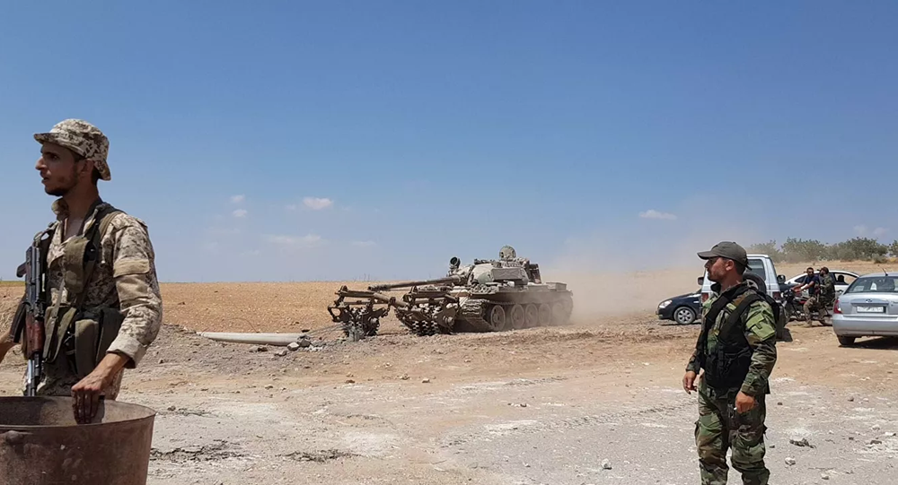 Syrian troops engaged in demining using specially equipped tank. File photo.