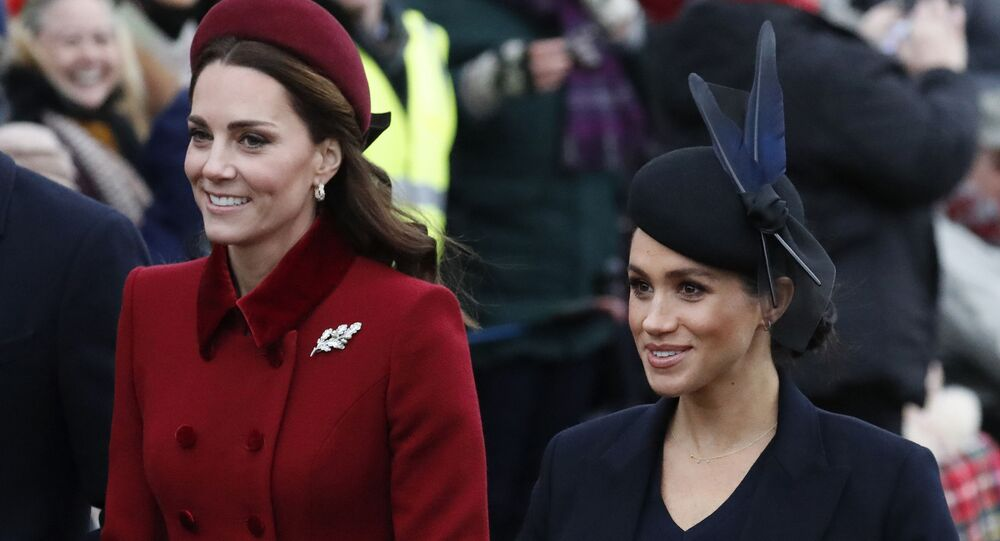 FILE - In this Tuesday, Dec. 25, 2018 file photo, Britain's Kate, Duchess of Cambridge, left, and Meghan, Duchess of Sussex arrive to attend the Christmas day service at St Mary Magdalene Church in Sandringham in Norfolk, England