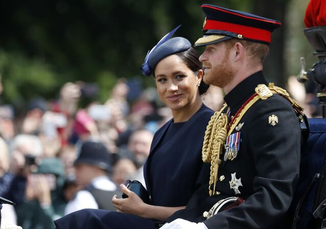 FILE - In this Saturday, June 8, 2019 file photo, Britain's Meghan, the Duchess of Sussex and Prince Harry ride in a carriage to attend the annual Trooping the Colour Ceremony in London